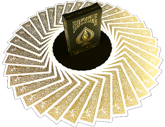 A pack of Bicycle brand playing cards, gold foil, with some cards decoratively fanned.